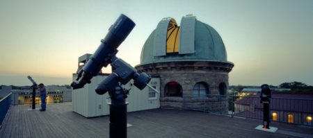 Photo: Rooftop telescopes and the vintage dome of Oberlin.